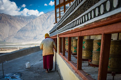 Walking the holy path.. Diskit Monastery ! (Robie..) Tags: ladakh leh diskit diskitmonastry buddhist prayerwheel mountains religious