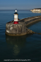 leaving port1 (photoautomotive) Tags: uk light sea england people lighthouse water wall port canon reflections fishing rocks waves cliffs newhaven ripples eastsussex breakwater seawater fishingrods 50d 35350l