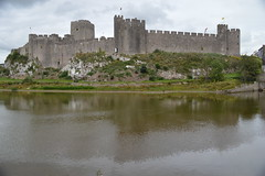 Castles of the UK: Pembroke (CoasterMadMatt) Tags: uk greatbritain summer lake west building tower castle heritage history castles water pool wall wales architecture landscape pembroke photography town nikon ruins scenery photos unitedkingdom fort britain south towers cymru ruin landmarks august landmark structure photographs ramparts gb outer sir towns fortress pembrokeshire attraction ruined outerwall nikond3200 sirbenfro benfro pembrokecastle d3200 castellpenfro southwestwales countytown coastermadmatt summer2015 coastermadmattphotography august2015 pembroke2015 castellpenfro2015 pembrokecastle2015