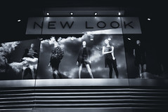 From New Heights They Looked Down (Skuggzi) Tags: uk england sky urban blackandwhite bw woman reflection mannequin monochrome fashion statue shop retail clouds shopping store clothing noir unitedkingdom britain avatar streetphotography lookingup lookup clothes scifi fujifilm dummy cyberpunk manikin technoir cityoflondon simulacrum womenswear xpro1