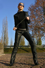 Cora 13 (The Booted Cat) Tags: red sexy girl leather hair model pants whip tight mistress dominatrix