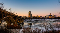 Frozen River at Sunset (jtaylor7779) Tags: sunset canada river bridges saskatoon bessborough saskatchewan