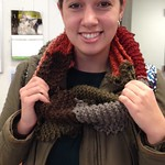 An art student posing with a scarf.