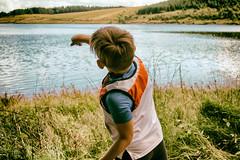 Kielder (Paul Walker 1966) Tags: water kielder throwing stone boy game fun childish child