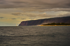 Na Pali Sunset (AgarwalArun) Tags: napalicoast pacificocean ocean water waves surf landscape napali ruggedcoastline cliffs sonya7m2 sonyilce7m2 hawaii kauai island scenic nature views mountain clouds boat sunset