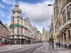 Gran Via (Jan Kranendonk) Tags: spain spanish madrid europe european city buildings architecture gran via cars traffic taxi cab transport busy urban sky blue sunny grand clouds street road capital travel hugging friends sidewalk life streetlife ngc
