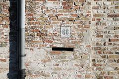 66. (Mona - B) Tags: europe belgium flanders flandre wall mur brick send letterbox letter poste bote lettre pipe color orange red rouge brown canon 66 bruges brugge