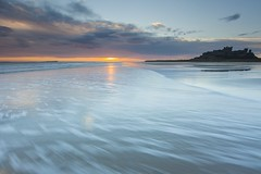 Shoreline sunrise (Carl Mick) Tags: sea wetsands eastcoast castle northeast robferrol ngc seascape sunrise northumberland clouds leefilters coast bamburghsunriseseascapecastle northeastcoast northyorkshire sand