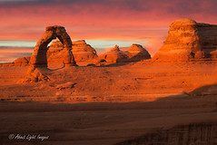 Delicate Arch Sunset Light_ (About Light Images Photography) Tags: delicatearch archesnationalpark southwest utah desert sunset landscapes clouds