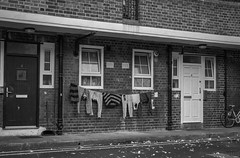 47/52: Winter draws on (judi may) Tags: 52weekchallenge 52in52 london lowkey lowlight washing washingline doors windows building canon7d blackandwhite mono monochrome architecture