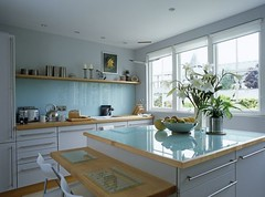 0029370328 (pennykcl) Tags: immaculate seating work surface shelves inside horizontal image indoors day photography colour nobody contemporary blue white kitchen fitted unit breakfast bar stool central island storage wooden top window flower arrangement shelving fruit bowl summer styled interior