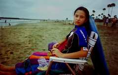 Karina Erickson_sitting on the beach_body board day (Larry R. Erickson) Tags: karinaerickson califroniagirlsatthebeach bodyboarding girlsboogieboarding
