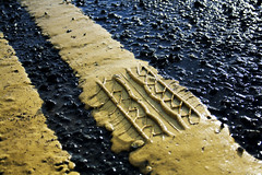 YellowGritRoad (tiki.thing) Tags: wet water road yellow pattern grit stones outdoors geometry 7dwf weathered