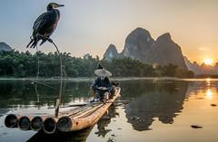 Cormorant Fisherman (shalabh_sharma7) Tags: china travel light sunset mountains water birds river cormorants liriver fisherman yangshuo tokina raft lantern guangxi cormorantfisherman karstmountains sonya77 sonya77ii