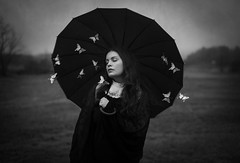 Army Of Butterflies (Maren Klemp) Tags: portrait blackandwhite woman selfportrait nature monochrome field animal umbrella butterfly outdoors loneliness butterflies surreal insects nostalgia nostalgic melancholy conceptual fineartphotography darkart evocative femalephotographer expressivephotography fineartphotographer darkartphotography femaleartwork
