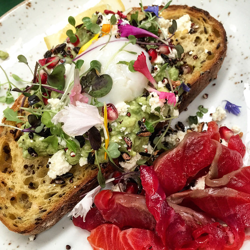 Smashed avocado on toast with a poached egg and house cured trout at Hobba in Prahran #breakfast #hobba #avocadotoast #food