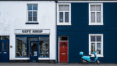 red white and blue take #1 (HHH Honey) Tags: minimoonxii sonya7rii sony70300g devon colours buildings red white blue redwhiteandblue house moped reddoor door windos torcross shop shopwindow giftshop contrasts opposites perfecteffects10 onone on1