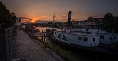 sunset in on the river (phlickrron) Tags: donau sunset outdoor city boat regensburg bavaria cityscape urban panorama