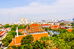 20130324-DSC_5826-HDR Area around Wat Saket Buddhist temple Bangkok Thailand (camera30f) Tags: bangkok buddhist buddhism temple religion site architecture thailand thai scene blue sky white clouds color gold orange buildings green trees nikon d800 city life lifestyle asia colors