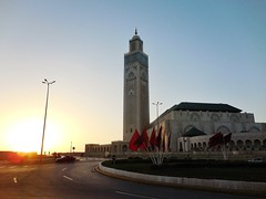 sunset at the Hassan II Mosque (SM Tham) Tags: africa morocco casablanca hassaniimosque architecture building mosque islam religion minaret tower sunset dusk road street flags streetlamp outdoors