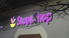 Stop & hop (Coyoty) Tags: stopshop sign humor funny shopping grocery market colors westhartford connecticut ct food supermarket night light neon store business branches brick trees orange yellow magenta green logo diagonal gray grey lines failure purple dark darkness