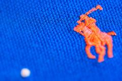 Unashamed Product Placement (LoomahPix) Tags: colour macromondays polo ralflauren blue closeup macro macrophotography orange stitch