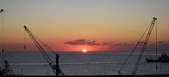 Construction of a new day (niro.fabio) Tags: alba sunrise mare sea seascape porto harbor sole sun gru viaggio industrial orizzonte horizon nikond5500 newday mattina nuovogiorno