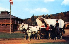 Frontier Town NY (Edge and corner wear) Tags: park wild people west tourism vintage wagon amusement town pc village postcard tourist covered western roadside attraction