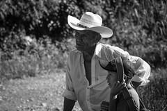 Bajo el calor de la tarde (Jos M. Hosttas) Tags: boy sunset portrait blackandwhite naturaleza man blancoynegro nature hat atardecer looking retrato guatemala father son cap heat gorra sombrero gazing padre fatigue nio hombre hijo calor cansancio altaverapaz senahu