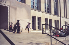 Library Dancin' (patrickkuhl) Tags: madison madisonwi wisc wisco wisconsin uwmadison library dancing street streetphotography color colorfilm film filmcamera filmisnotdead filmphotography analog 35mm leica leicam6 m6 summicron summicronc 40mm kodak kodakgold expired expiredfilm people shadows