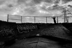 writer's.block (jonathancastellino) Tags: toronto figure fence sun weather cloud clouds grasp graffiti leica q block writersblock surface gap friend drain infrastructure