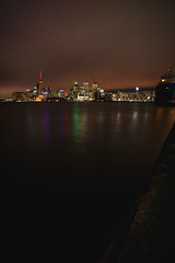 Toronto Skyline at night (kevingomes1) Tags: lenstagger toronto skyline night light buildings sky cn tower skyscraper boat water waterfront polson pier lake ontario canada big city cityscape landscape