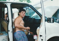 ERNIE WORKING ON HIS ASTRO VAN IN AUG 1993 (richie 59) Tags: ulstercountyny ulstercounty newyorkstate newyork unitedstates generalmotors chevrolet townofesopusny townofesopus richie59 stremyny stremy america outside people summer chevyvan frontyard van man driveway oldphotograph olddays oldphoto 1993 photoscan brother 1986chevyastro 1986chevy 1986astro astro aug141993 aug1993 35mmfilm 35mm filmcamera filmphotography film person minivan men 1990s 1980sminivan 1980svan americanminivan americanvan usminivan usvan automobile auto motorvehicle vehicle hudsonvalley midhudsonvalley midhudson nystate nys ny usa us whitevan gm gmvan vaninterior opendoor sideview noshirt openhood dashboard frontseats bigbrother olderbrother