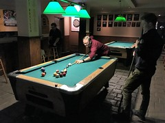 Alan shoots (JuhaOnTheRoad) Tags: newyork iphone bar pool billiards