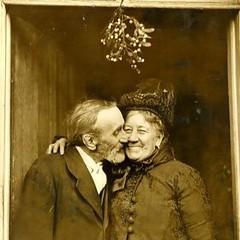 Old happy couple (kevin63) Tags: lightner photo old antique vintage victorian edwardian elderly couple kissing mistletoe christmas holiday happy sepia