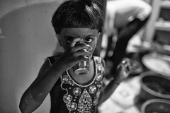 The Drinker (alisdair jones) Tags: ef35mmf14lusm girl child cup drink portrait nainativu srilanka