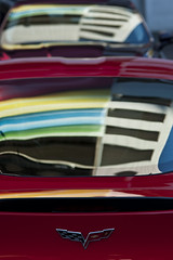 Cars parked in parking lot with colors reflected onto winshiled (Jim Corwin's PhotoStream) Tags: seattle city windows abstract building guy cars glass car vertical metal closeup reflections outdoors photography rainbow parkinglot colorful downtown pattern patterns shapes streetscene expressionism vehicle windshield railing multicolored closeups visualart carwindow reflectedlight urbanscene colorshapes rainbowofcolors glassreflections vehiclewindow carwinshield rmetalreflections