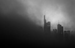 Smoke City (One_Penny) Tags: city sky urban blackandwhite bw white black building fog skyline architecture clouds skyscraper canon germany dark deutschland photography town smog hessen sinister frankfurt smoke minimal frankfurtammain 6d ffm