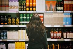 Tough Decisions (cookedphotos) Tags: toronto girl shopping store fuji streetphotography shelf liquor scotch decision lcbo project365 23mm xt1 365project vsco p3652015