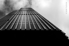 Breaking into the clouds - Tower 42, London (rewtuffphotos) Tags: tower42 natwesttower skyscraper london oldbroadstreet canon clouds sky tower city cities highrise blackwhite mono bw buildings travel