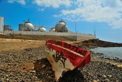 Can You Smell Gas? (tcees) Tags: beach sky clouds rowingboat stones graffiti lascaletas lanzarote disa boat lpg gastanks canaryislands canaries