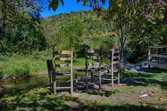 Pull up a chair and sit a spell (ucumari photography) Tags: ucumariphotography vallecrucis nc194 north carolina nc october 2016 chairs stream dsc5660