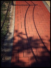 Bricks and Shadows (Firery Broome) Tags: architecture sidewalk brick pattern shadows fence metal chainlink treeshadows fenceshadows sunlight silhouette brickwalkway newark delaware universityofdelaware cellphone phonephoto iphone iphone5s iphoneography phoneography ipad ipaddarkroom apps snapseed grass weeds fencefriday red green brown gray autumn afternoon everydayobject orange 365 lines abstract