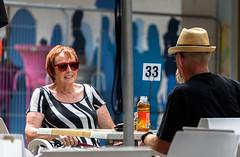 I Love My Photo Taken (Jocey K) Tags: newzealand christchurch building city sign people street newregentst cafes chairs tables mural streetart painting artwork hat