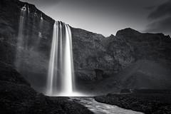 Seljalandsfoss (GrandJr) Tags: blue grandjr nikon 24mm bw longexposure water waterfall iceland izland landscape d3 europe rocks outdoor fx hoya nd nd1000 ngc monochrome blackandwhite