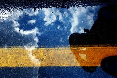 Lane Rain (formulanone) Tags: rain buddle shoes shadow clouds pavement stripe yellowline selfie