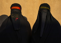 Portrait of iranian shiite muslim women with their faces hidden by a veil mourning imam hussein on tasua during the chehel manbar ceremony one day before ashura, Lorestan province, Khorramabad, Iran (Eric Lafforgue) Tags: 2people 30s adultsonly ashura ceremony chadors chehelmanbar clothing colorimage covered face hidden horizontal hussain imamhussein iran islam khorramabad lookingatcamera memorialevent middleeast mourners mourning muharram muslims mysterious mystery niqab outdoors people persia portrait religion religious ritual shia shiism shiite tasoua tasua twopeople unrecognizableperson veiled waistup women womenonly lorestanprovince ir
