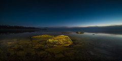 Colors in the dark (Tore Thiis Fjeld) Tags: norway oslo maridalsvannet dark stones evening lake water quiet fog panorama forest wilderness sky transparent outdoors nikon d800 samyang 14mm le longexposure color mist reflection mirror