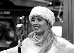 Street portrait, busker, Canterbury (chrisjohnbeckett) Tags: street portrait urban monochrome bw blackandwhite people canterbury winter canonef135mmf2lusm chrisbeckett microphone retro sing singer smile dents busker busking performer nosering