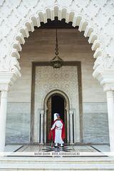 Mausoleum of Mohammed V - Rabat, Morocco (Naomi Rahim (thanks for 2 million hits)) Tags: rabat morocco africa northafrica 2016 travel travelphotography wanderlust nikon nikond7200 man guard mausoleumofmohammedv tomb crypt arabic moorish architecture redcape arch door